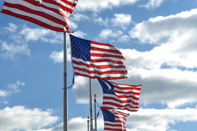 American Flags in the Wind. With Clouds royalty free stock photos