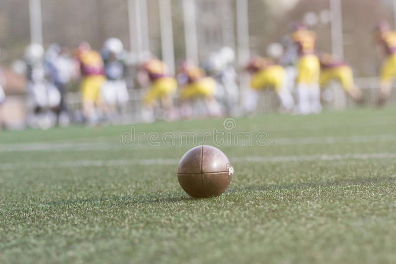 American football ball on the field stock image