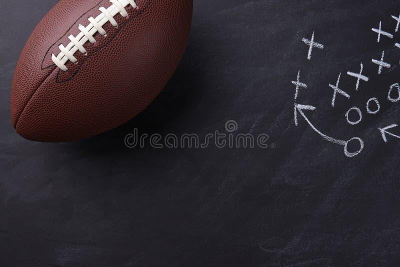 American Football on Chalkboard stock photography