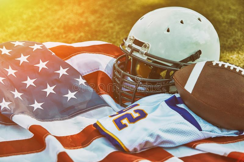 American football concept. a uniform of an American football player on the grass a park. Patriotism of the national game stock photos