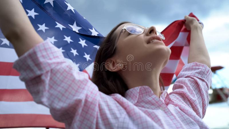 American football fan holding flag and singing USA anthem to support team, cheer. Stock photo royalty free stock photos