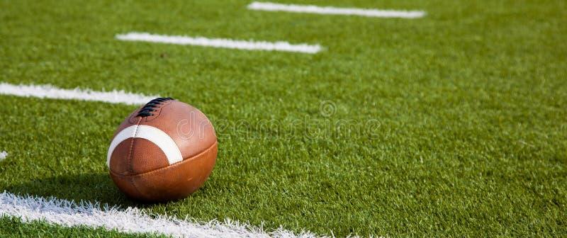 An American football on field stock photos