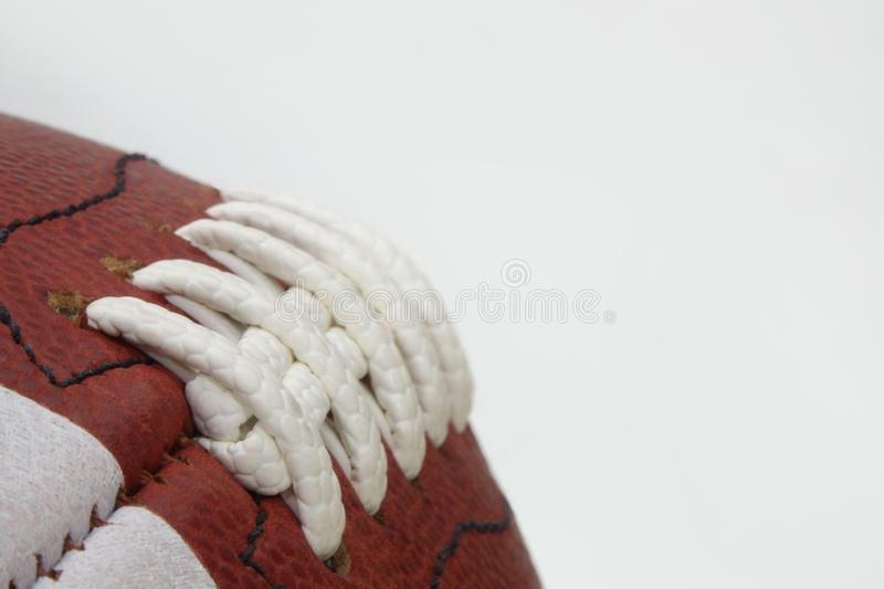 American Football Game Ball Laces and Texture Detail Against a White Background stock photos