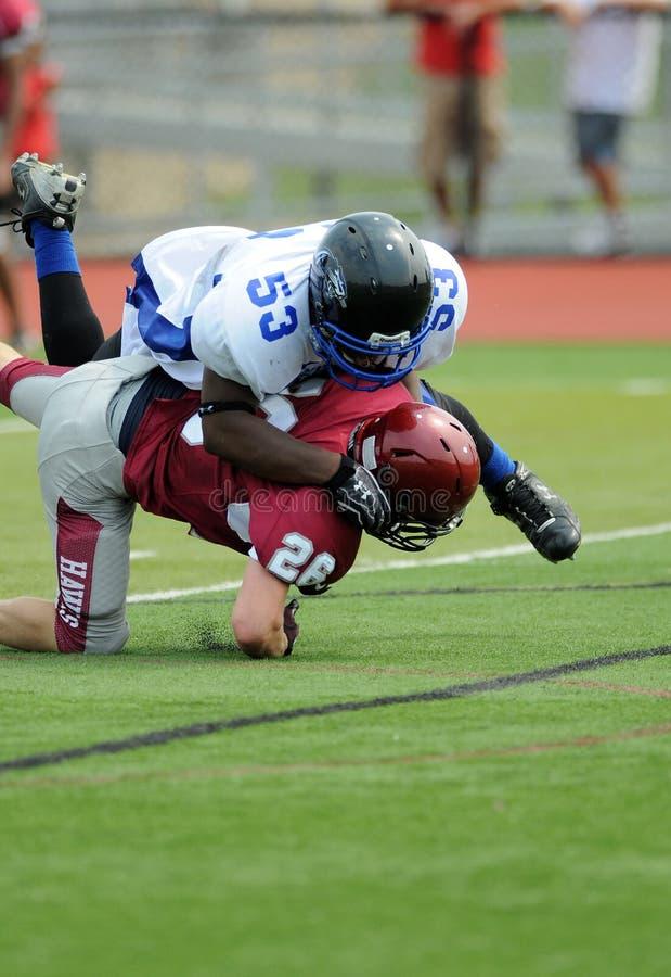 American football game - hard tackle royalty free stock photo
