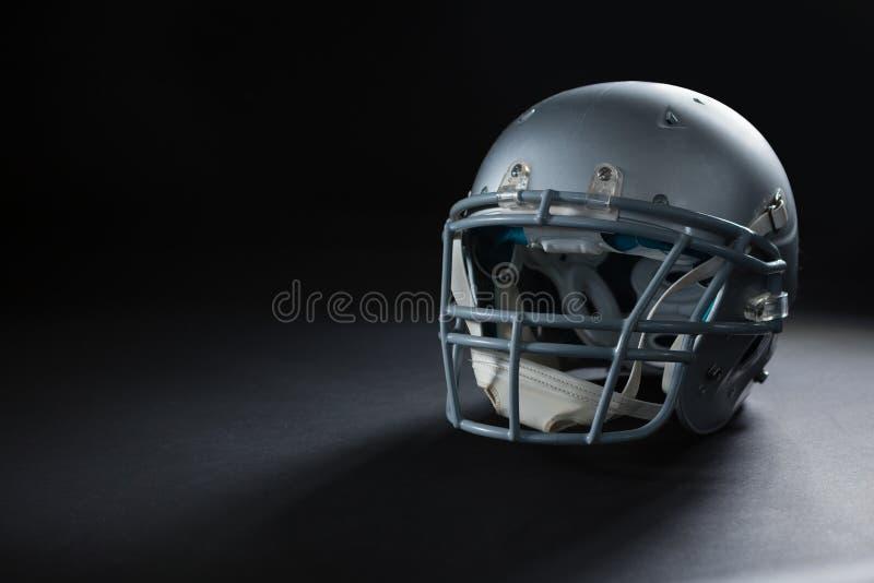 American football head gear on a black background. Close-up of American football head gear on a black background stock photo