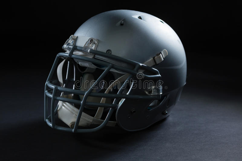 American football head gear on a black background. Close-up of American football head gear on a black background royalty free stock photo