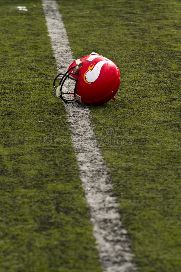 American football helmet. Lying on the grass royalty free stock photography
