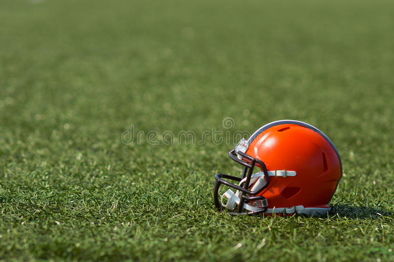 American football helmet. At the artificial grass playing field stock photo