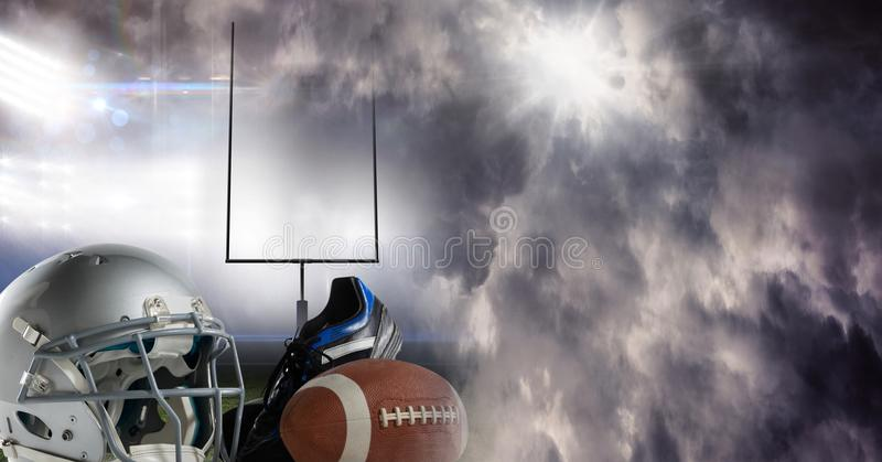 American football helmet ball and gear equipment with stadium transition. Digital composite of American football helmet ball and gear equipment with stadium royalty free stock photo