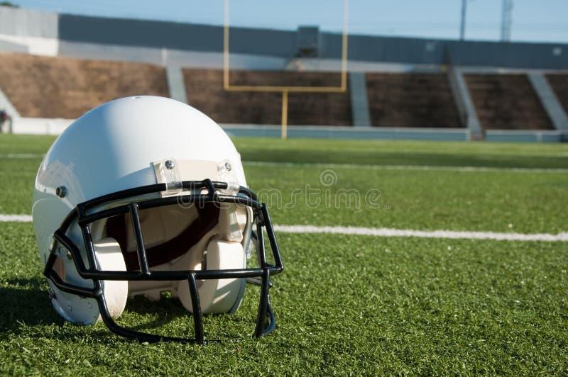 American Football Helmet on Field royalty free stock photo
