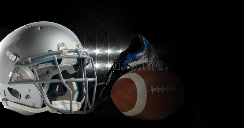 American football helmet and gear equipment with dark lights transition transition. Digital composite of American football helmet and gear equipment with dark stock image