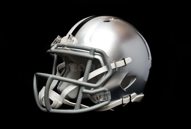 American football helmet. Silver american football helmet isolated on black background royalty free stock images
