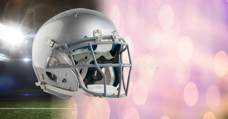 American football helmet with stadium transition. Digital composite of American football helmet with stadium transition royalty free stock image