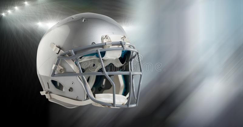 American football helmet with stadium transition. Digital composite of American football helmet with stadium transition stock photo