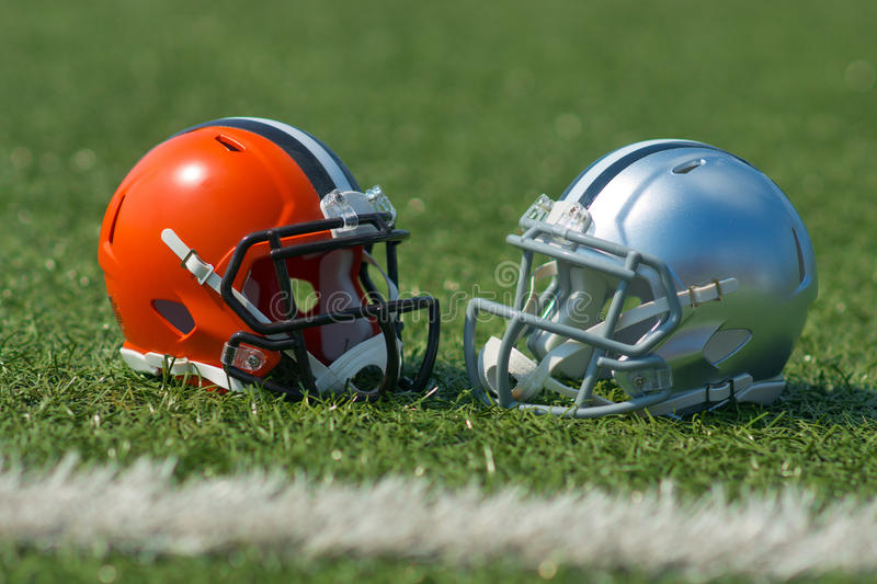 American football helmets. At the artificial grass playing field stock photo