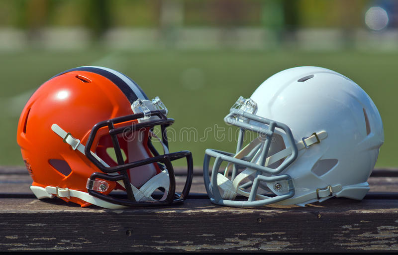 American football helmets. At the artificial grass playing field royalty free stock images