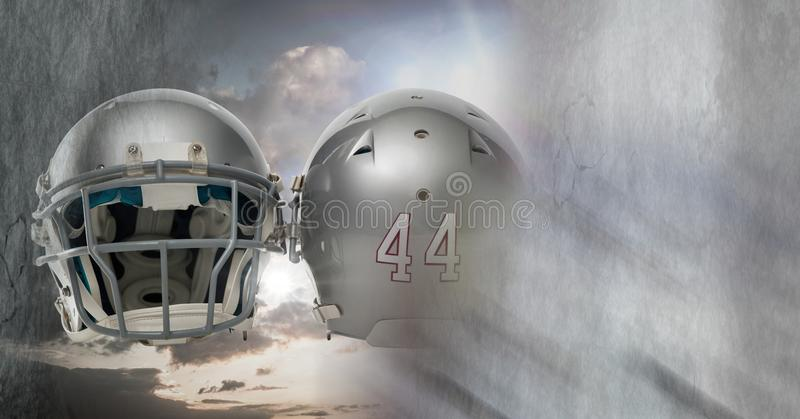 American football helmets with sky transition. Digital composite of American football helmets with sky transition royalty free stock image