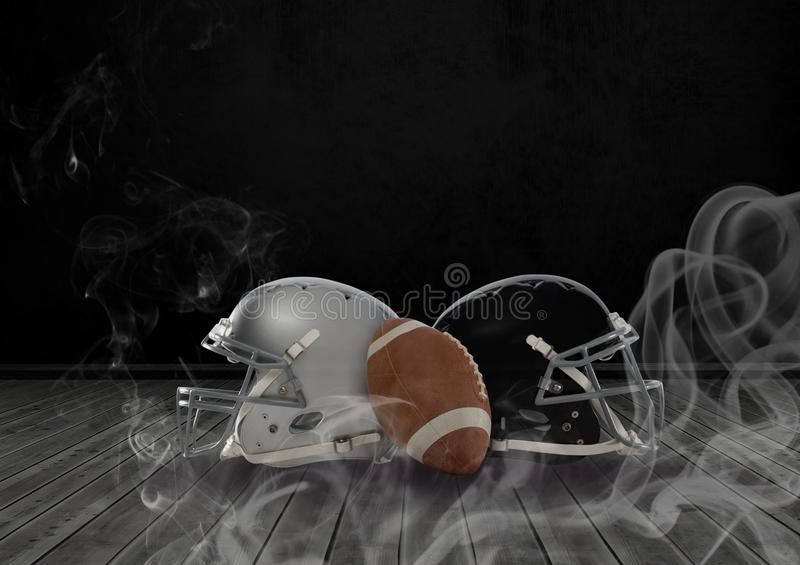 American football and helmets in smoke. Digital composite of American football and helmets in smoke stock image