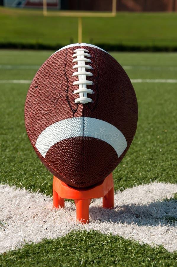American Football on Kicking Tee Closeup royalty free stock images