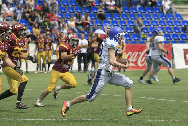 American Football Match Between Wolves And Blue Dragon stock image