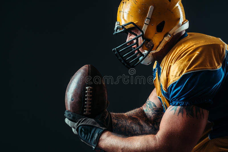 American football offensive player with ball royalty free stock photo