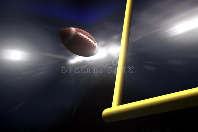 American football over goal post at night stock photography