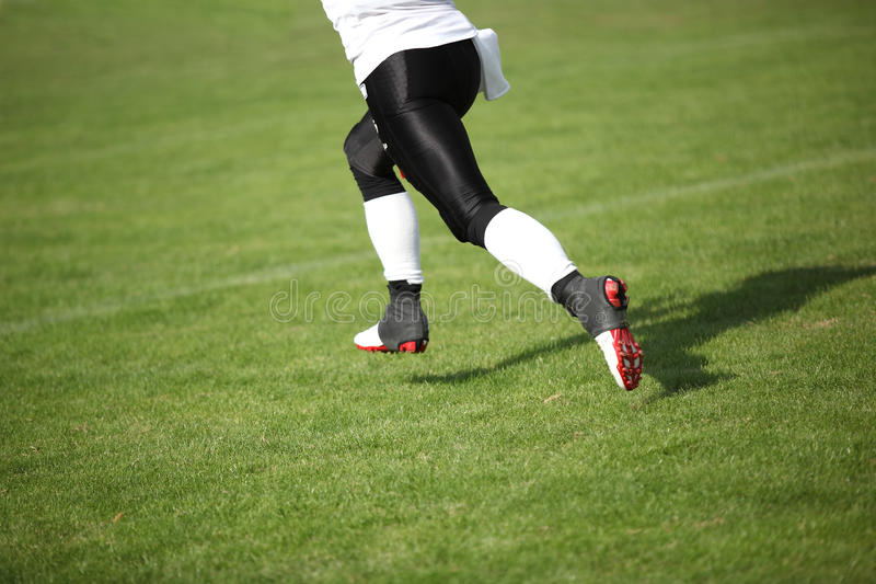 American Football Player. A Football Player is running during a football match stock photo