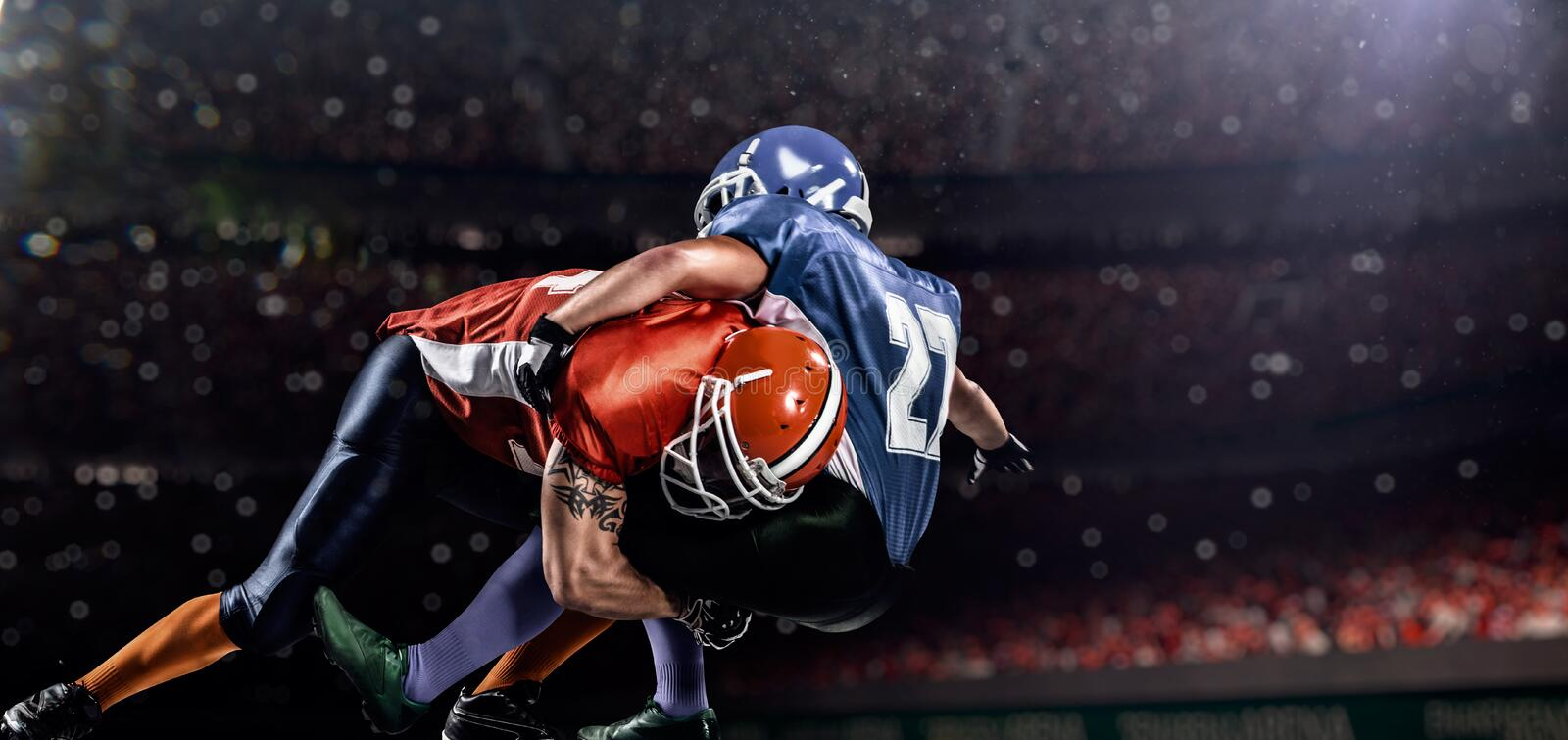 American football player in action on stadium stock photos