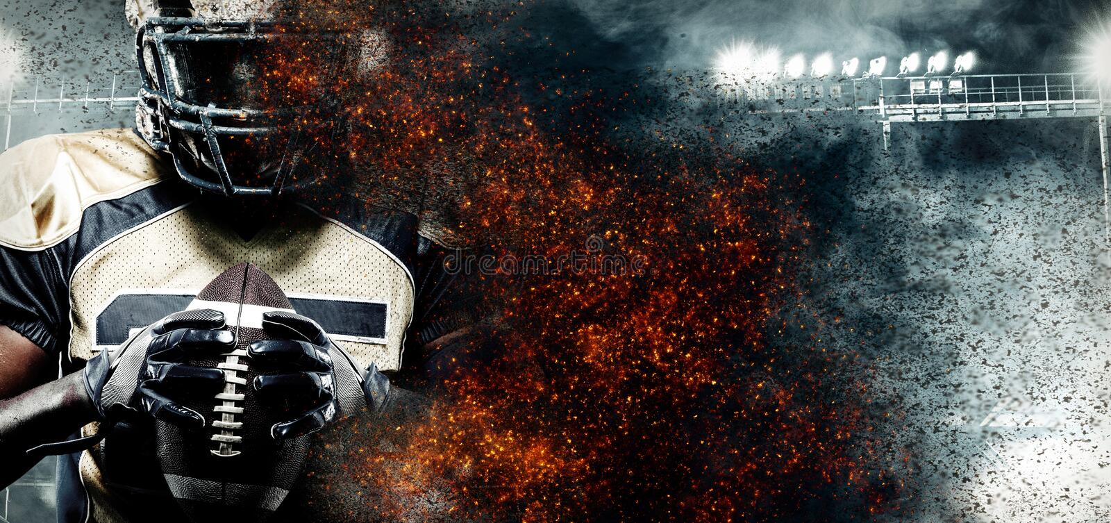 American football player, athlete in helmet on stadium in fire. Sport wallpaper with copyspace on background. stock photos