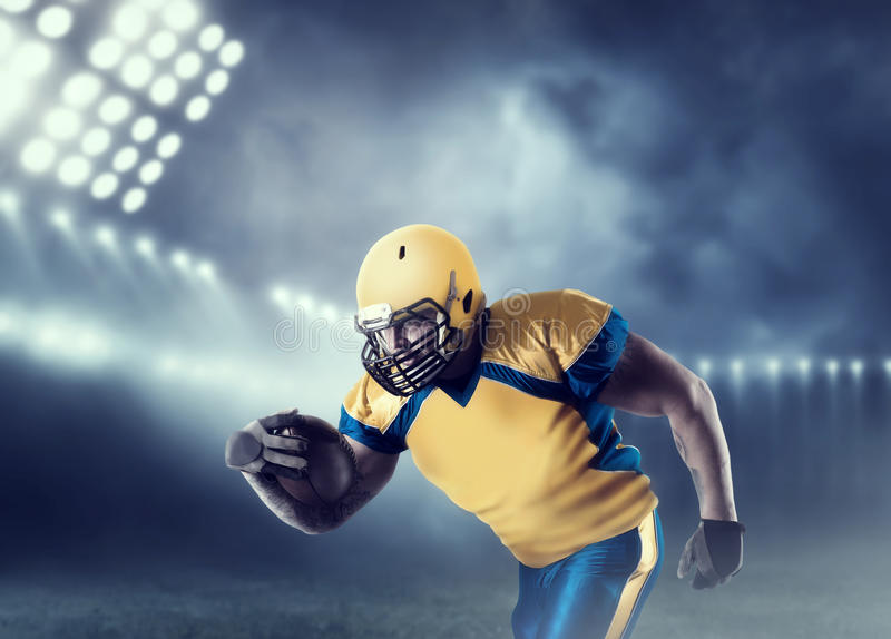 American football player with ball on sport arena stock photos