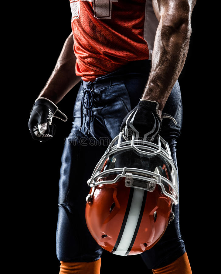 American football player in black isolated stock photo