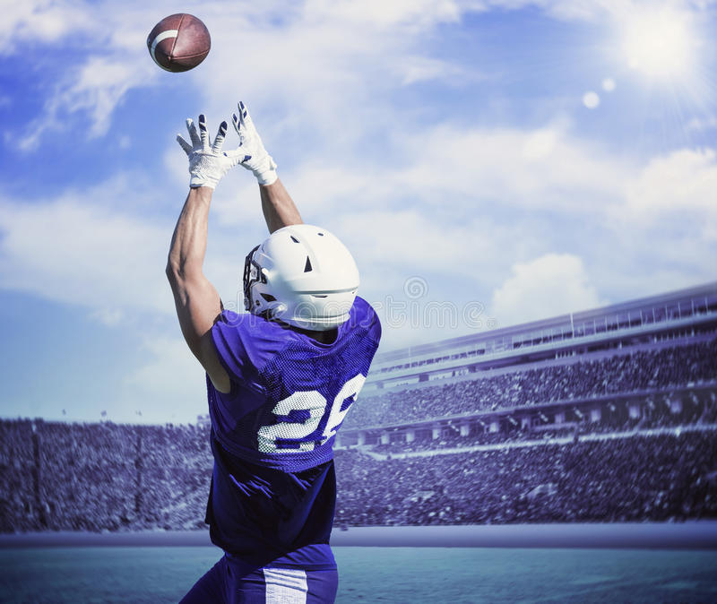 American Football Player Catching a touchdown Pass royalty free stock image
