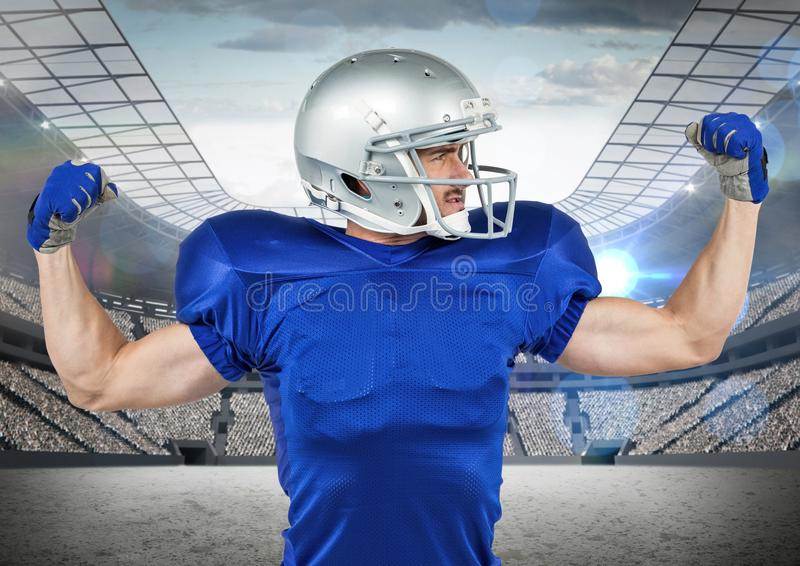 American football player cheering with clenched fists in stadium royalty free stock photography