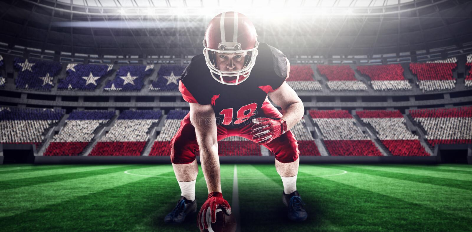 Composite image of american football player in helmet taking position royalty free stock photos