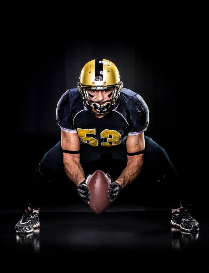 American football player holding ball stock image