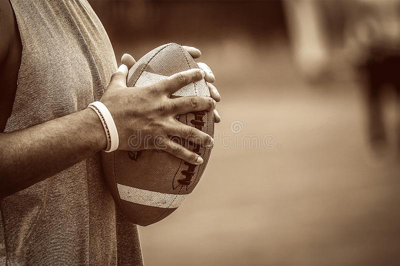 American football player holding the ball stock photography
