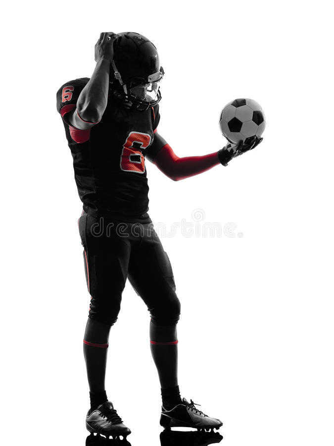 American football player holding soccer ball confused silhouett stock image