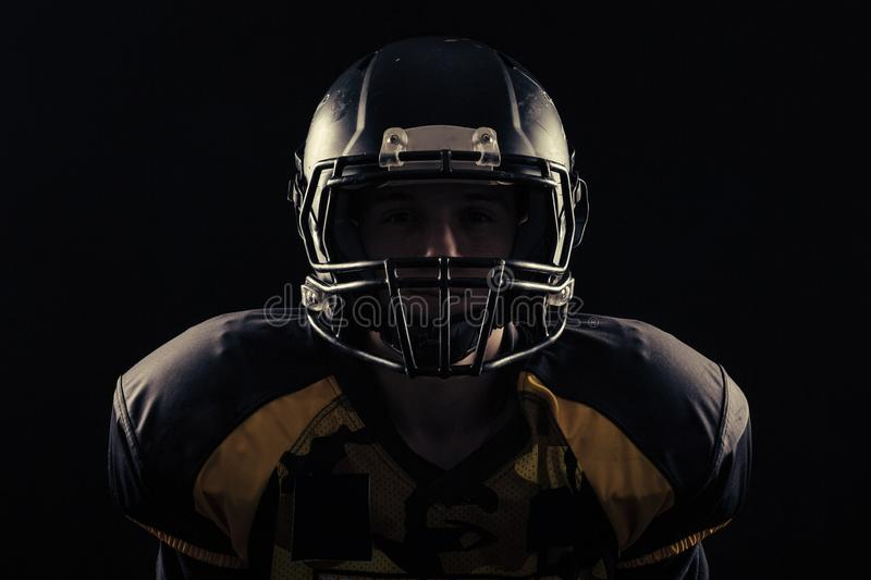American football player isolated on black background stock image