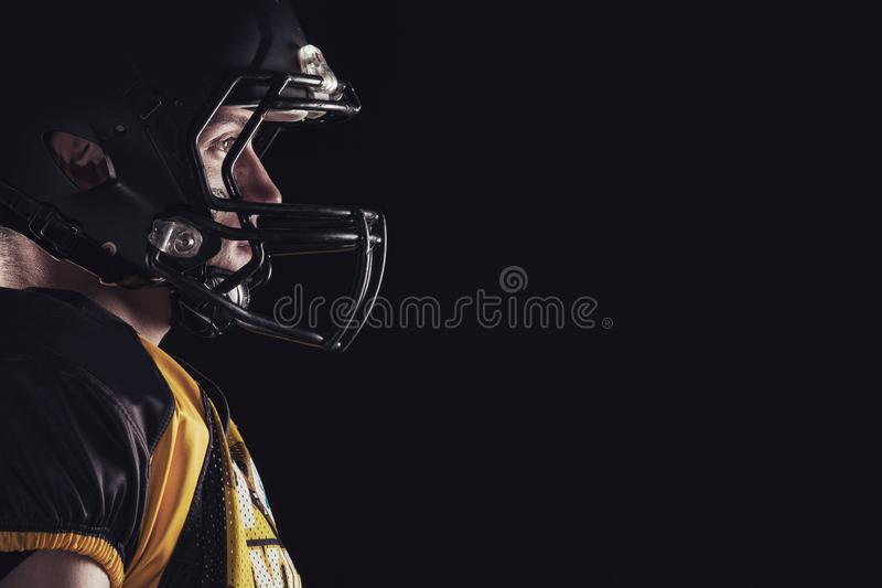 American football player isolated on black background royalty free stock image