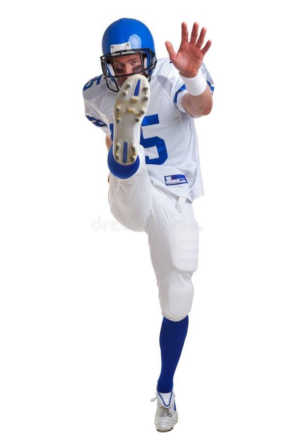 American football player kicking royalty free stock photos