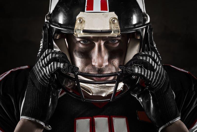 American football player looking at camera. Portrait of american football player looking at camera with intense gaze royalty free stock photos