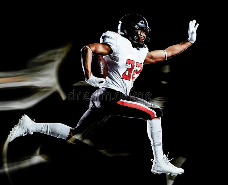 American football player man isolated black background light painting royalty free stock images