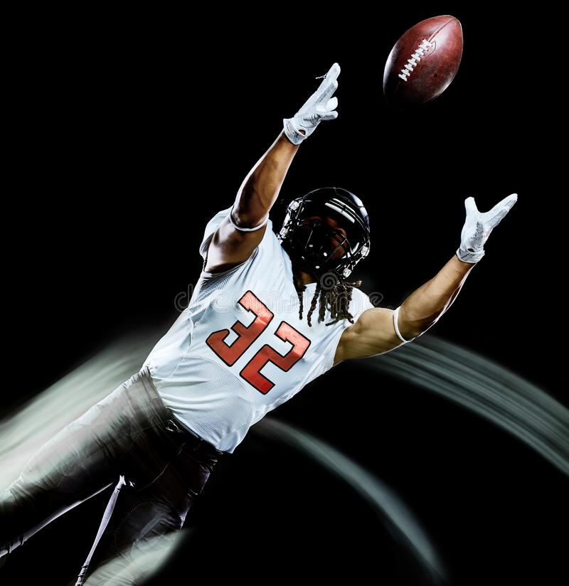 American football player man isolated black background light painting stock photos