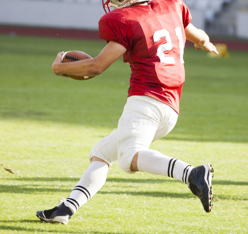 American football player running with the ball royalty free stock images