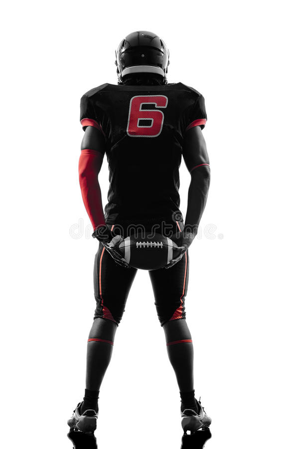 American football player standing holding ball silhouette royalty free stock photo