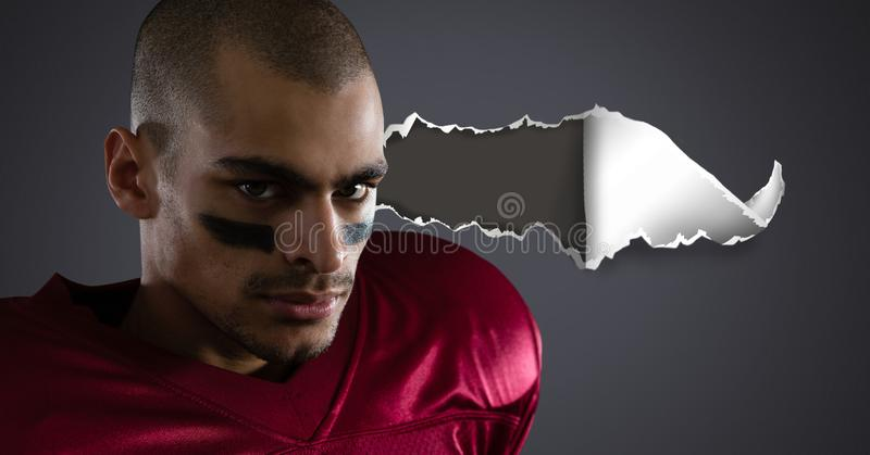 American football player with torn paper stock photo