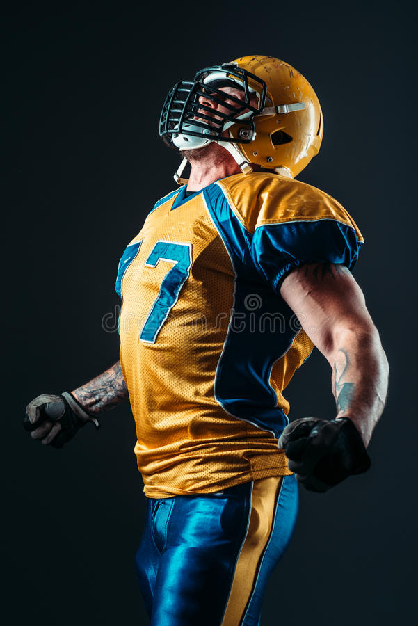 American football player in uniform and helmet stock photos