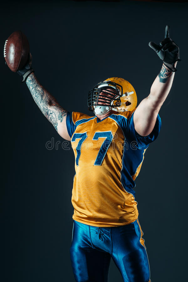 American football player in uniform and helmet royalty free stock photos