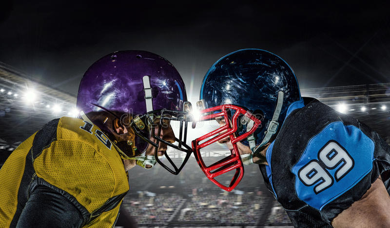 American football players at arena . Mixed media stock photo