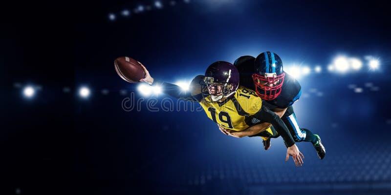 American football players at arena . Mixed media royalty free stock images